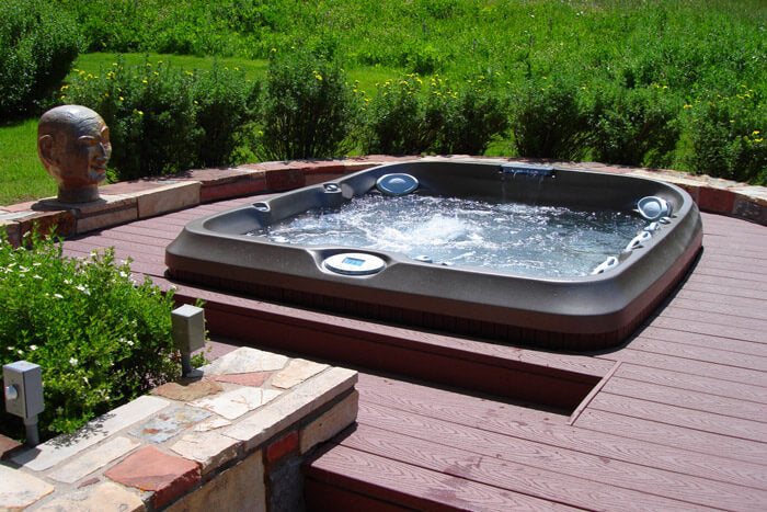 A Jacuzzi hot tub built into the decking
