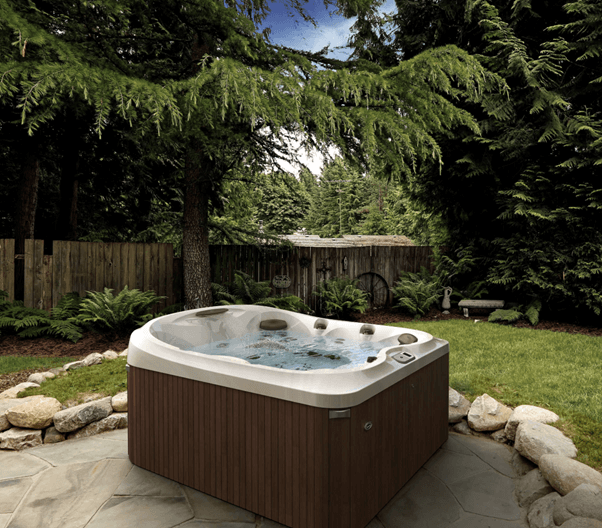 outdoor living hot tub in a leafy backyard