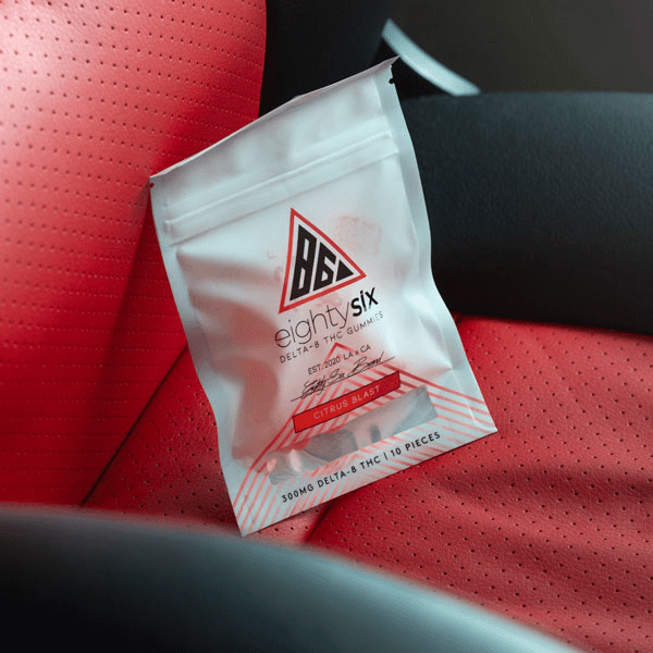 Delta-8 Citrus Blast gummies on a red leather seat