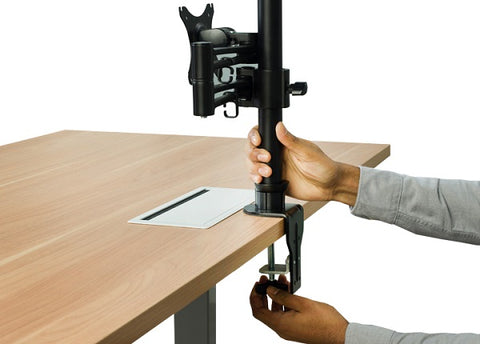 Photo of hands screwing adjustable monitor riser