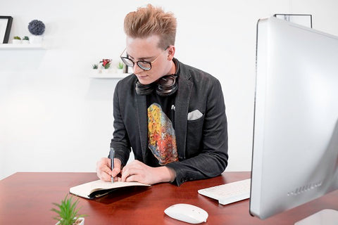 Photo of a young man preparing with communication to bosses to convince them to switch to standing desks.
