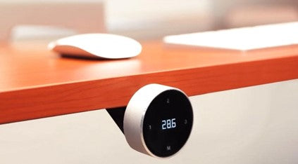 Standing desk hand remote with rotational control