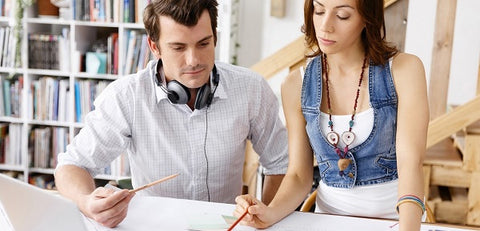 Photo of a team of two young people who are working on a project