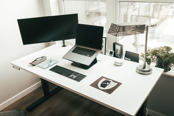 Monitor stand for a desk