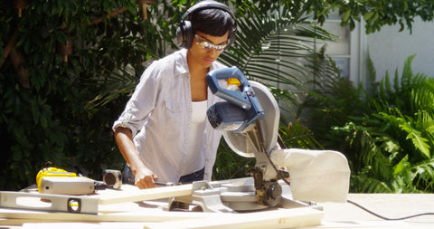 Photo of a girl cutting wood with a table saw