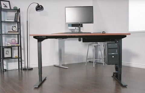 Photo of a standing desk with a computer in a room