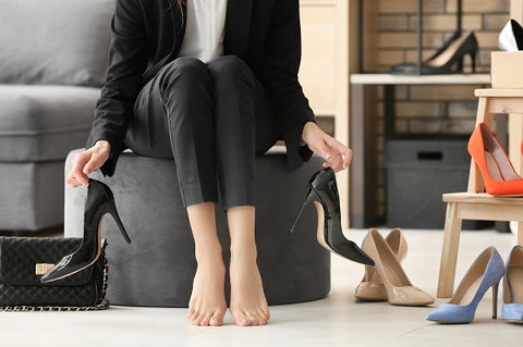 Woman choosing shoes for standing desk