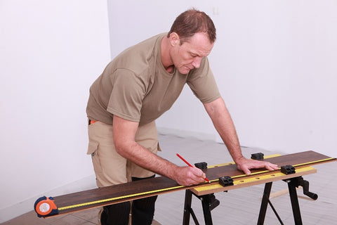 Photo of a man working on a workbench