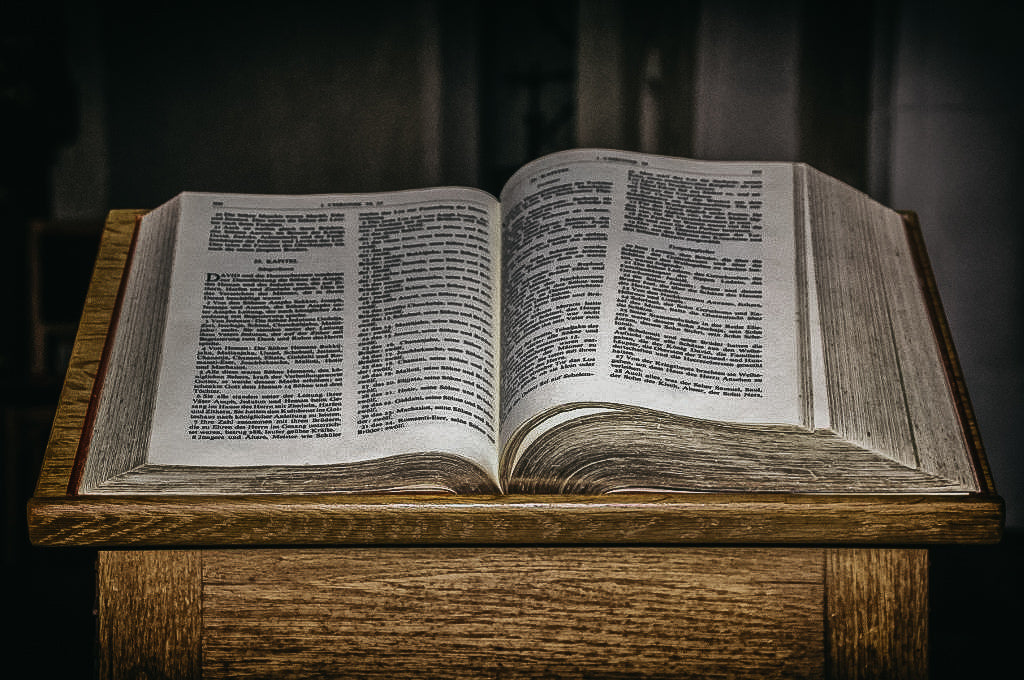 Who is qualified to read the Bible in church?