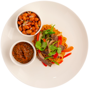 Beef Fajitas with Spanish Brown Rice, Fajita Vegetables, Seasoned Pinto Beans, and Salsa Quemada