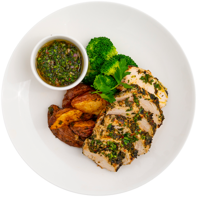 Chimichurri chicken breast with herb roasted red potatoes, steamed broccoli, and sauce on side