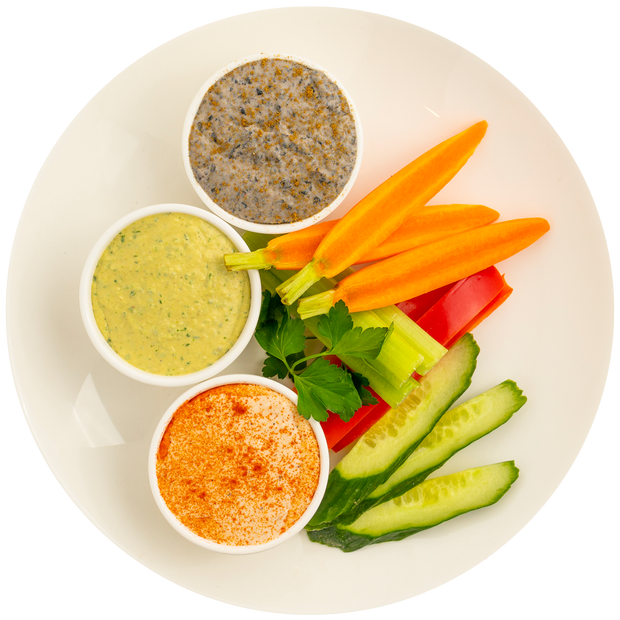 Hummus Trio with Hummus, Black Bean Cumin Hummus, Cilantro Jalapeno Hummus, and Carrots, Bell Peppers, and Cucumbers
