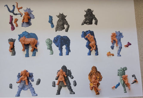 3D Prints over an image of the 3D sculpts