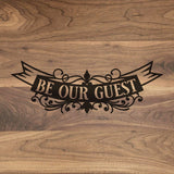 "Be Our Guest Banner - Engraved Walnut Cutting Board (11"" x 16"") - Hailey Home"