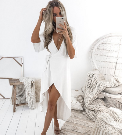 Deep V cross strap with irregular dress