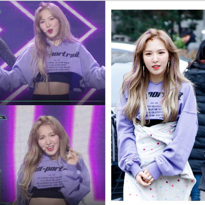 Wendy with the same PEEK A BOO letter printed high waist exposed navel sweater