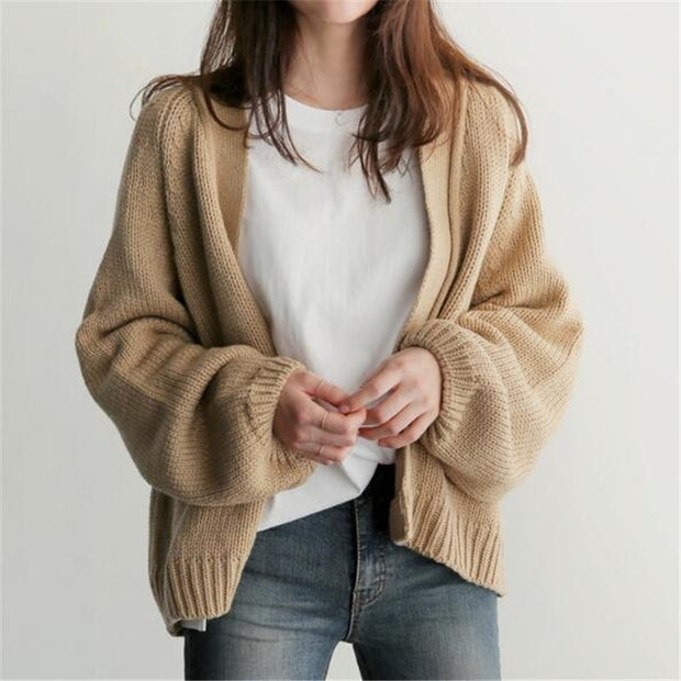 A short, long sleeve cardigan is versatile