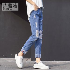 7750#2018 autumn fashion new pants light hole flanging nine points across the pants jeans lady