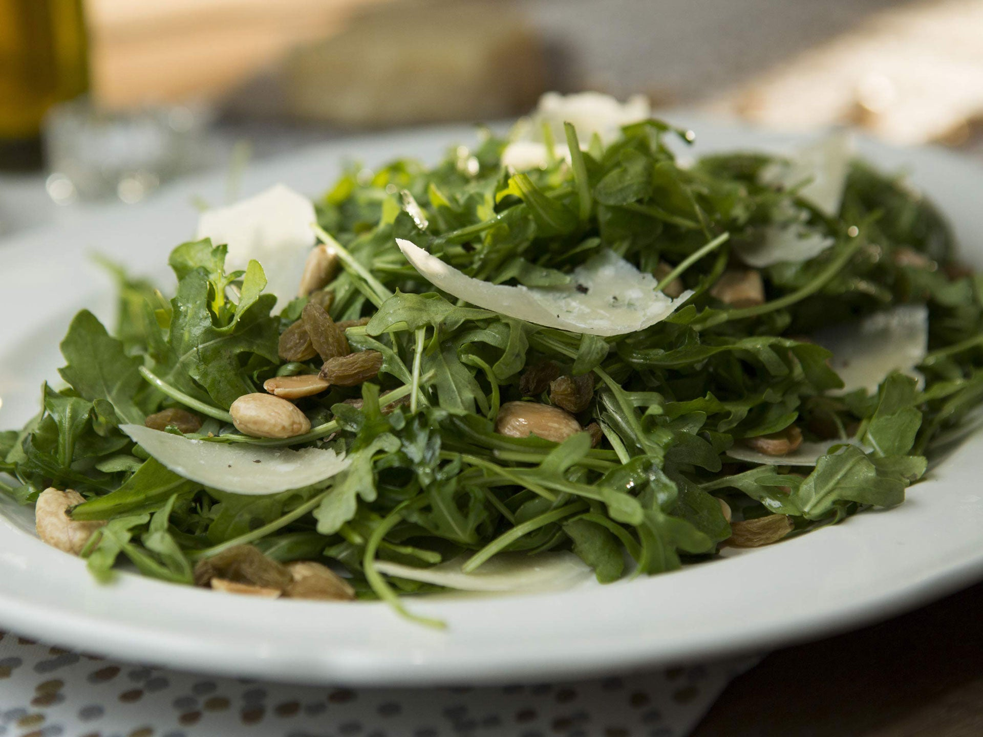 Arugula salad with shaved Parmesan cheese and marcona almonds