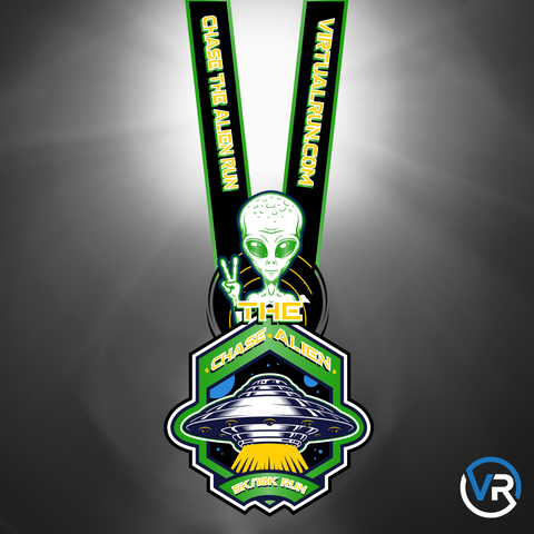 Image of Virtual Run Chase The Alien 5K and 10K finisher medal with alien giving the peace sign with logo ribbon to go around neck