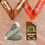 Two finisher medal discount package for the Chocoholic Frolic series with a candy bar and hershey kiss