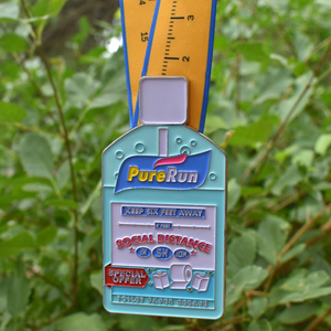 Hand sanitizer bottle finisher medal displayed for Social Distance 1k 5K 10K virtual run race