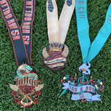 Tattoo art inspired 5K 10K finisher run medals displayed on grass after race