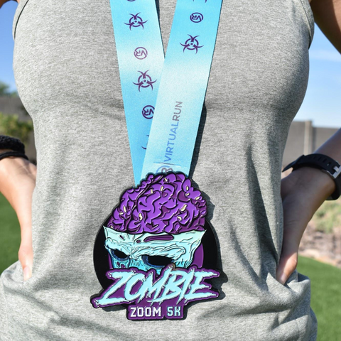 Zombie Zoom is a 5K virtual race and this is the finisher medal with zombie brains coming out of a walking dead skull fear of the walking dead 5K on female running participant.