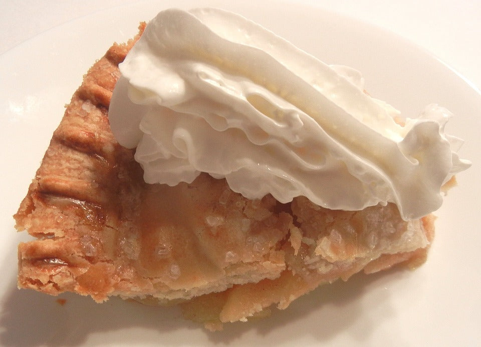 apple pie on plate with whipped cream