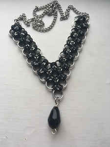 V-shaped chainmaille necklace in silver & black with black teardrop bead accent