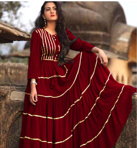 Stunning Maroon Colored Partywear Pure heavy reyon with gota patti work  Gown