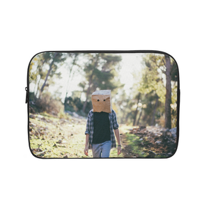 The Hiding Face Laptop Sleeve