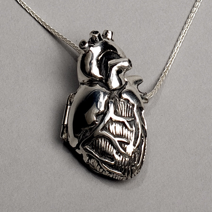 original silver anatomical heart locket peggy skemp jewelry