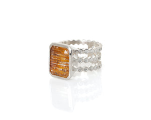 Emerald cut, rutilated topaz, topaz, faceted topaz, rutile, included topaz, included gemstone, gem collector, peggy skemp jewelry, jewelry addict