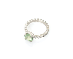 prehnite honeycomb ring in silver, flower cut prehnite, flower cut gem, honeycomb jewelry, peggy skemp jewelry, solitaire ring with green stone and hand engraved gem seat, four prong setting