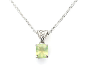 "radiant cut faceted prehnite gem in solid silver honeycomb setting with 1.5mm silver cable chain, 18"" long. The prehnite semi precious gemstone is set in claw prongs. The stone is a milky mint green color, semi opaque, an intriguing gemstone in an unusual cut."