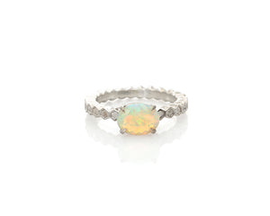 Opal ring with Ethiopian fire opal, claw prongs, silver faceted opal ring with flashes of green, blue, yellow, electric orange and pink, beautiful silver solitaire opal ring