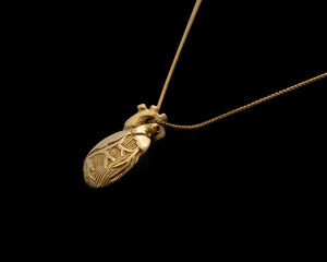 14ky Gold Anatomical Half Heart Necklace