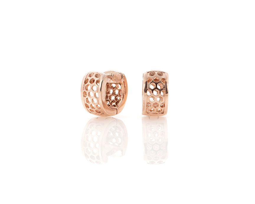 rose gold huggie hoop earrings, 1cm small comfortable solid gold earrings in rose gold, handcrafted in Chicago, IL, designed and hand-finished by Peggy Skemp.