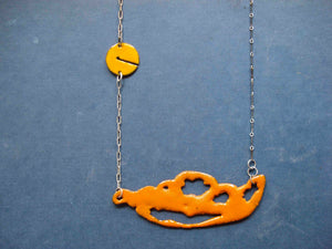 Orange sugar fired vitreous enamel on copper, glass enamel phasmid necklace by Peggy Skemp 2008 from the Sensitive Parasite collection.