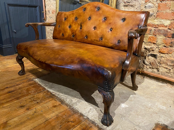 Early Georgian Irish ball and claw foot camel back sofa Chippendale in look.