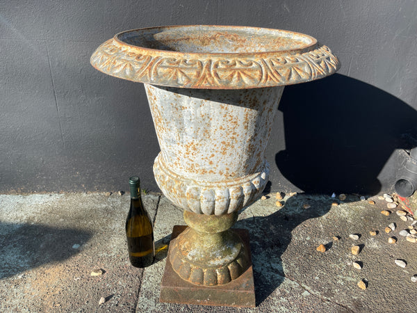 A beautiful Victorian large architectural cast iron garden urn with good casting and aged patina.