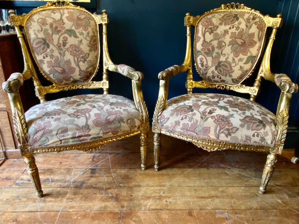 Exceptional Pair Of Transitional Giltwood & Gesso Louis XVI carved giltwood fauteuil Chairs attributed to Georges Jacob; circa 1780