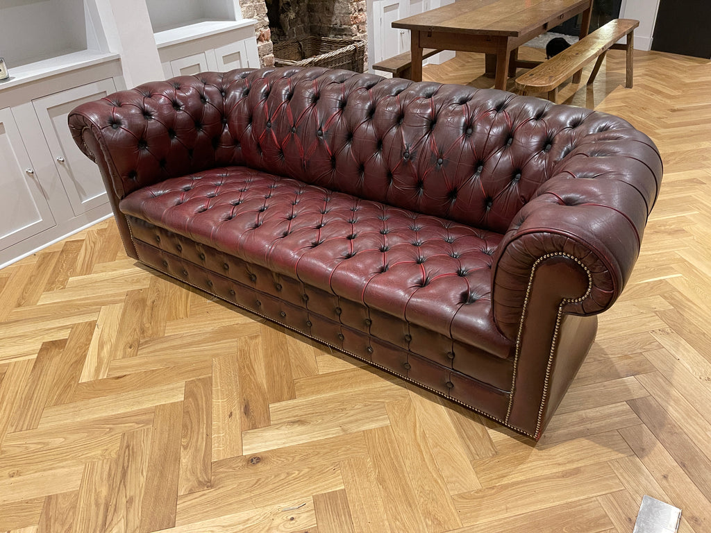 Exceptional Oxblood Leather Chesterfield Antique Hand Dyed Sofa.