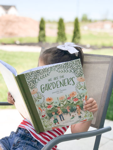 Lizzy reading We are Gardeners