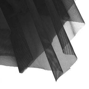 Black in colour, close up of the mesh skirt attached to leotard. Pas de bourree dancewear. Pasdebourreedancewear.