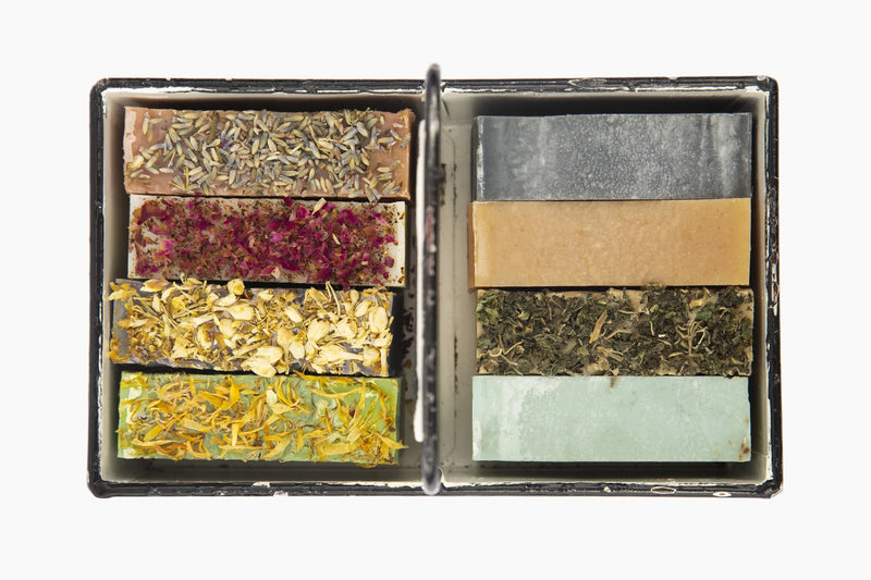 A Metal rustic Tray with 8 Organic Luxurious Moroccan Casablanca Soap Topped with Herbs and Flowers  Edit alt text