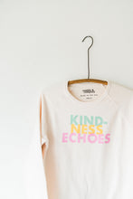 Load image into Gallery viewer, Ramble and Company's kindness echoes soft comfortable inspirational graphic raglan sweatshirt in petal pink close up hanging
