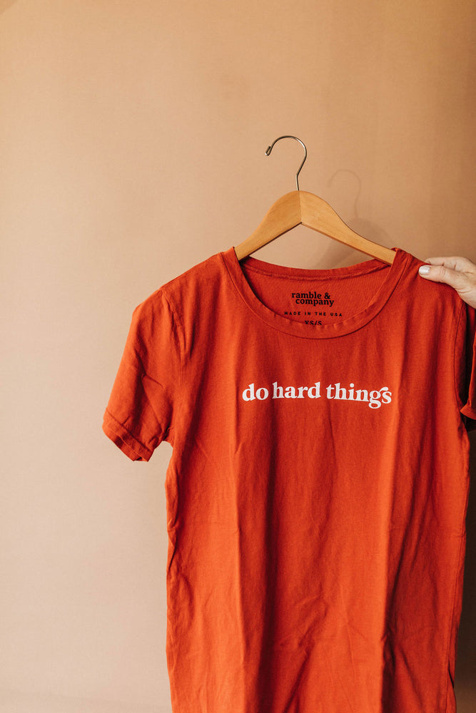 the do hard things tee | gold flame