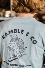 Load image into Gallery viewer, woman wearing Ramble and Company's let the good times roll armadillo on scooter vintage slim fit unisex soft comfortable inspirational graphic t-shirt  in harbor gray light blue color close up back view